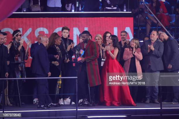 Jason Derulo and Camila Cabello present Janet Jackson with the Global Icon Award on stage during the MTV EMAs 2018 at Bilbao Exhibition Centre on...