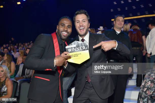 Jason Derulo and Luke Bryan celebrate their win for Performance of the Year during the 2017 CMT Music awards at the Music City Center on June 7 2017...
