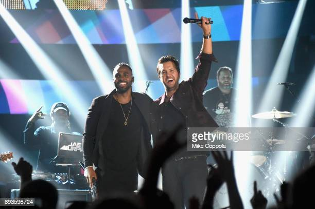 Jason Derulo and Luke Bryan perform onstage during the 2017 CMT Music awards at the Music City Center on June 7 2017 in Nashville Tennessee