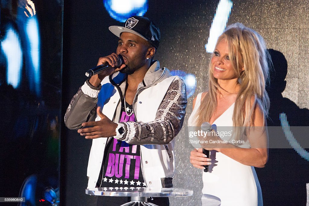 Jason Derulo and Pamela Anderson on stage during the ceremony of the World Music Awards 2014 at Sporting Monte-Carlo on May 27, 2014 in Monte-Carlo, Monaco.