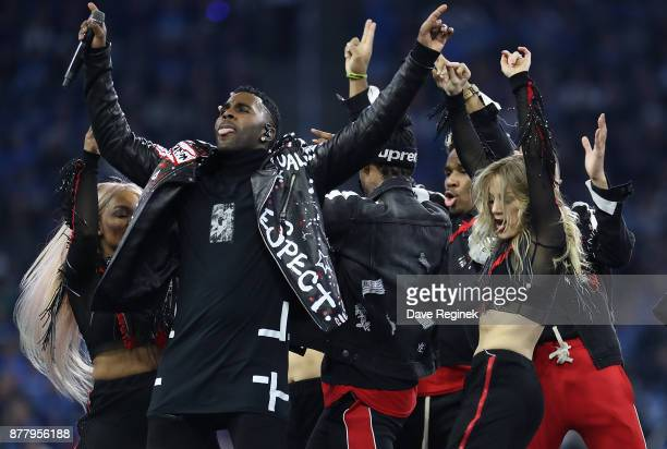 Jason Derulo performs during halftime during an NFL game at Ford Field on November 23 2016 in Detroit Michigan