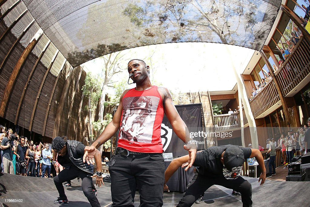 Jason Derulo (red) performs onstage at the Warner Bros. Records Summer Sessions held at Warner Bros. Records outdoor patio on August 16, 2013 in Burbank, California.