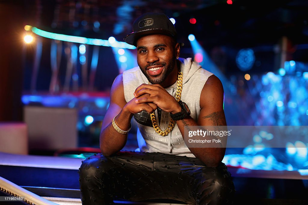 Jason Derulo poses in the Wonderwall Portrait Studio at the iHeartRadio Ultimate Pool Party Presented by VISIT FLORIDA at Fontainebleau's BleauLive in Miami featuring live performances by Pitbull, Ke$ha, Afrojack, Icona Pop, Krewella and Jason Derulo on June 29, 2013 in Miami Beach, Florida.