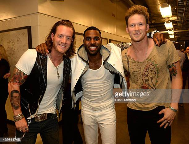 Jason Derulo poses with Tyler Hubbard and Brian Kelley of Florida Georgia Line backstage during the 2014 CMT Music Awards at Bridgestone Arena on...