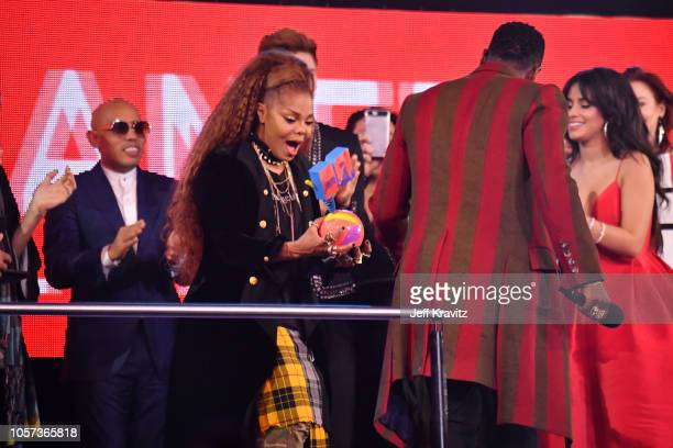 Jason Derulo presents Janet Jackson with the Global Icon Award on stage during the MTV EMAs 2018 on November 4 2018 in Bilbao Spain