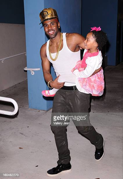 Jason Derulo walking with his 5 years old niece after she introduce him onstage at William H. Turner Technical Arts High School's student Talent Show...