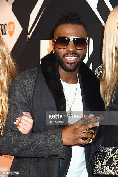 Jason Derulo with a drink and cigar attend the MTV EMA's 2015 at Mediolanum Forum on October 25 2015 in Milan Italy