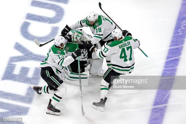 Jason Dickinson Alexander Radulov and Mattias Janmark of the Dallas Stars grab on to Anton Khudobin as they celebrate their 32 overtime victory...