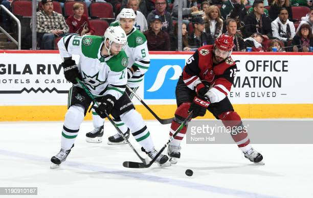 Jason Dickinson of the Dallas Stars and Brad Richardson of the Arizona Coyotes battle for control of the puck during the third period of the NHL...