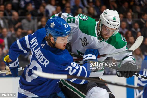 Jason Dickinson of the Dallas Stars battles for position against William Nylander of the Toronto Maple Leafs during the first period at the Air...