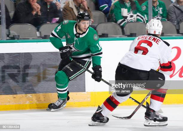 Jason Dickinson of the Dallas Stars handles the puck against Andy Greene of the New Jersey Devils at the American Airlines Center on January 4 2018...