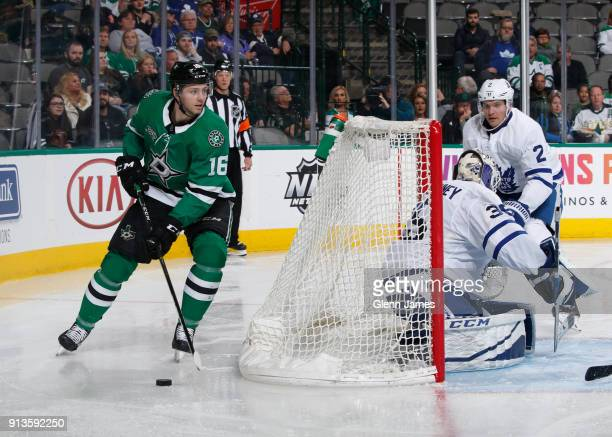 Jason Dickinson of the Dallas Stars handles the puck behind the net against the Toronto Maple Leafs at the American Airlines Center on January 25...