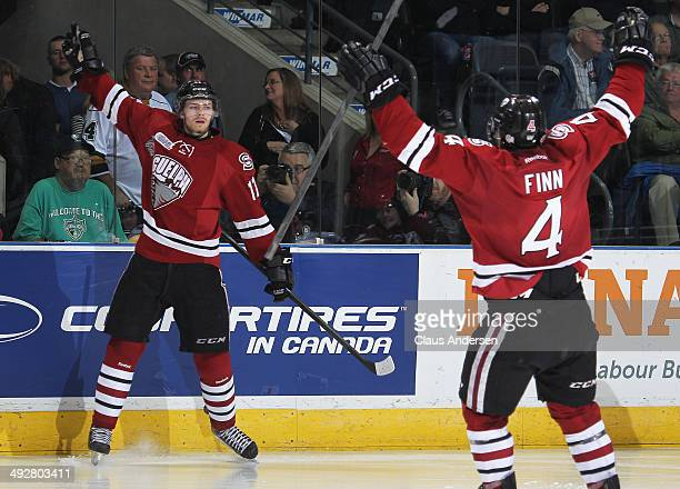 Jason Dickinson of the Guelph Storm celebrates a goal against the London Knights in Game Six of the 2014 MasterCard Memorial Cup at Budweiser Gardens...