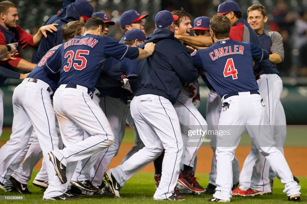Jason Donald #16 of the Cleveland Indians is mobbed by his teammates after hitting a walk-off single during the twelfth inning against the Chicago White Sox at Progressive Field on October 2, 2012 in Cleveland, Ohio. The Indians defeated the White Sox 4-3.