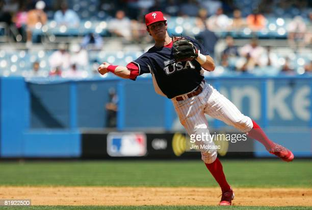 Jason Donald of the Philadelphia Phillies and playing for the United States Olympic Team throws to first against the World Futures Team during the...