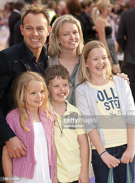Jason Donovan And Angela Malloch Arriving At The Uk Film Premiere Of 'Hannah Montana' At The Odeon Leicester Square London