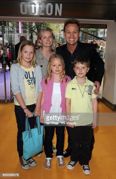 Jason Donovan and Angela Malloch with his two children Zach and Jemma arriving at the UK Film Premiere of 'Hannah Montana' at the Odeon West End...
