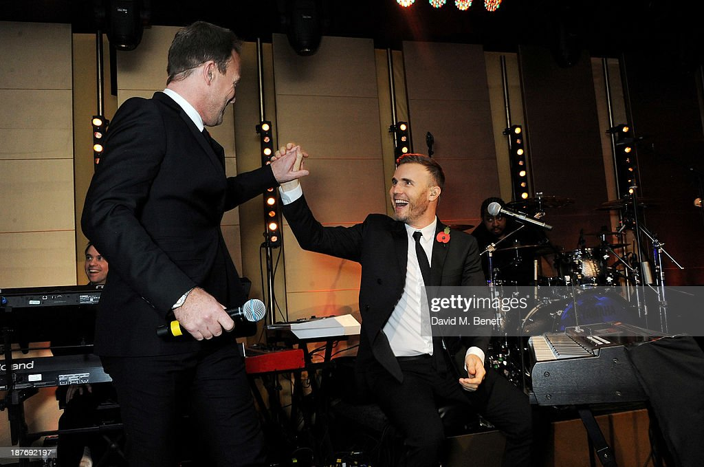 Jason Donovan (L) and Gary Barlow attend the BBC Children in Need Gala hosted by Gary Barlow at The Grosvenor House Hotel on November 11, 2013 in London, England.