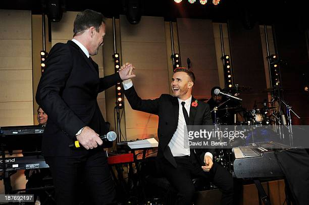 Jason Donovan and Gary Barlow attend the BBC Children in Need Gala hosted by Gary Barlow at The Grosvenor House Hotel on November 11 2013 in London...