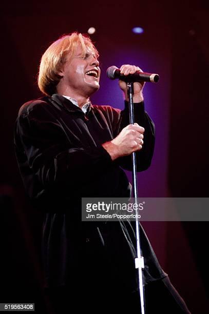Jason Donovan performing on stage circa 1990.