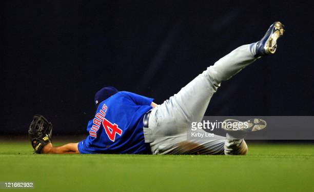 Jason Dubois of the Chicago Cubs comes up short on a diving catch in the third inning of 21 victory over the Los Angeles Dodgers in 10 innings at...