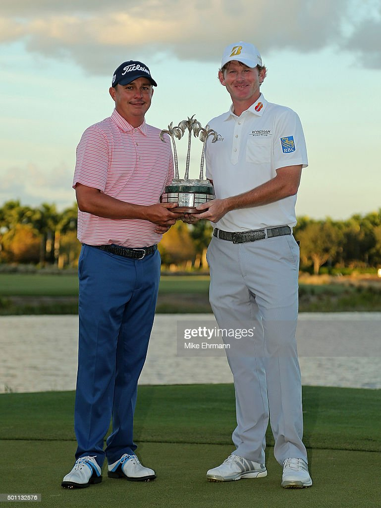 Jason Dufner and Brandt Snedeker pose with the trophy after winning the Franklin Templeton Shootout at Tiburon Golf Club on December 12, 2015 in Naples, Florida.