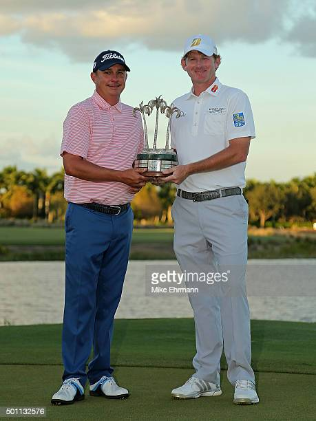 Jason Dufner and Brandt Snedeker pose with the trophy after winning the Franklin Templeton Shootout at Tiburon Golf Club on December 12, 2015 in...