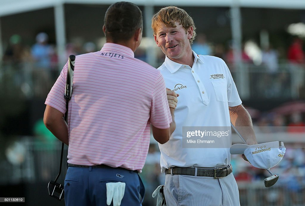 Jason Dufner and Brandt Snedeker react on the 18th hole after winning the Franklin Templeton Shootout at Tiburon Golf Club on December 12, 2015 in Naples, Florida.