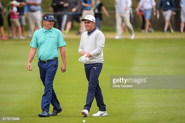 Jason Dufner and Rickie Fowler smile while talking on the first hole fairway during the first round of the World Golf Championships Dell Match Play...