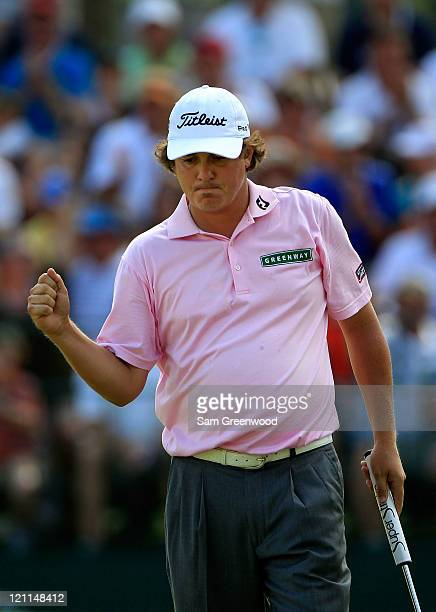Jason Dufner celebrates a birdie putt on the 13th green during the final round of the 93rd PGA Championship at the Atlanta Athletic Club on August 14...