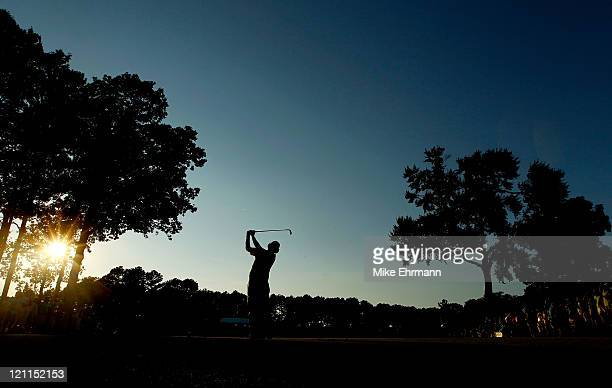 Jason Dufner hits his tee shot on the second playoff hole during the final round of the 93rd PGA Championship at the Atlanta Athletic Club on August...