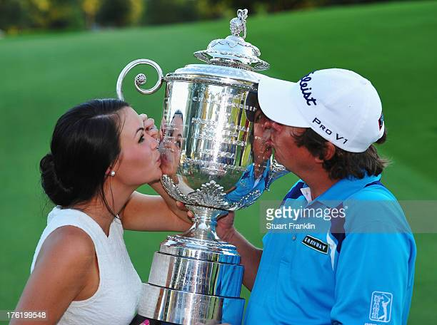 Jason Dufner of the United States and his wife Amanda kiss the Wanamaker tophy after his twostroke victory at the 95th PGA Championship at Oak Hill...
