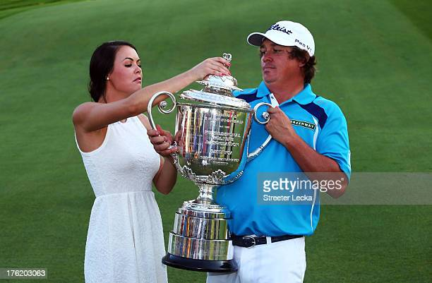 Jason Dufner of the United States and his wife Amanda pose with the Wanamaker Trophy on the 18th green after his twostroke victory at the 95th PGA...