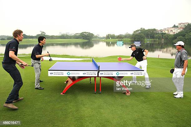 Jason Dufner of the United States and Ian Poulter of England play table tennis durin the Opining ceramony of the 2014 Volvo China Open at Genzon Golf...