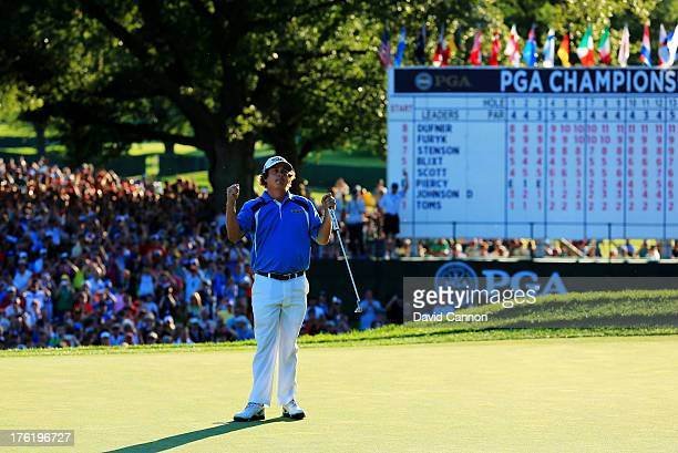 Jason Dufner of the United States celebrates on the 18th green after his two-stroke victory at the 95th PGA Championship at Oak Hill Country Club on...