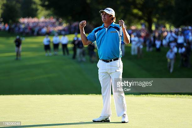 Jason Dufner of the United States celebrates on the 18th green after his twostroke victory at the 95th PGA Championship at Oak Hill Country Club on...