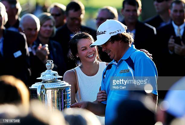 Jason Dufner of the United States celebrates with his wife Amanda on the 18th green after his twostroke victory at the 95th PGA Championship at Oak...