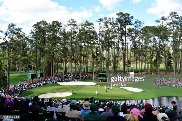 Jason Dufner of the United States Ernie Els of South Africa and Bernd Wiesberger of Austria play the 16th green during the first round of the 2017...