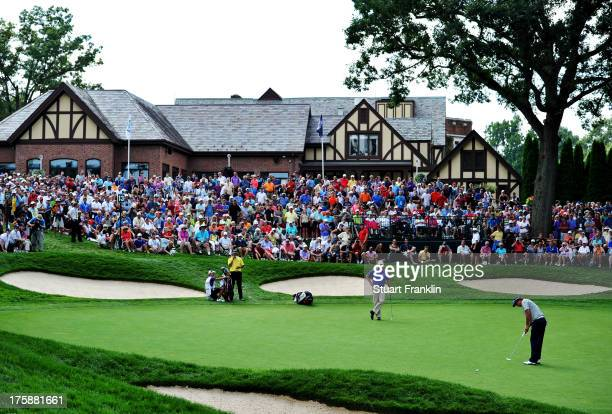 Jason Dufner of the United States hits a putt on the 13th green during the second round of the 95th PGA Championship on August 9, 2013 in Rochester,...