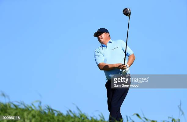 Jason Dufner of the United States hits a shot during a practice round prior to the Sentry Tournament of Champions at the Plantation Course at Kapalua...