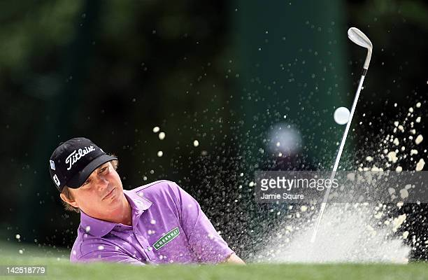Jason Dufner of the United States hits a shot out of the bunker on the 18th hole during the second round of the 2012 Masters Tournament at Augusta...