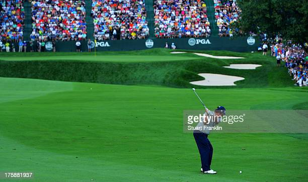 Jason Dufner of the United States hits his approach shot on the 18th hole during the second round of the 95th PGA Championship on August 9, 2013 in...