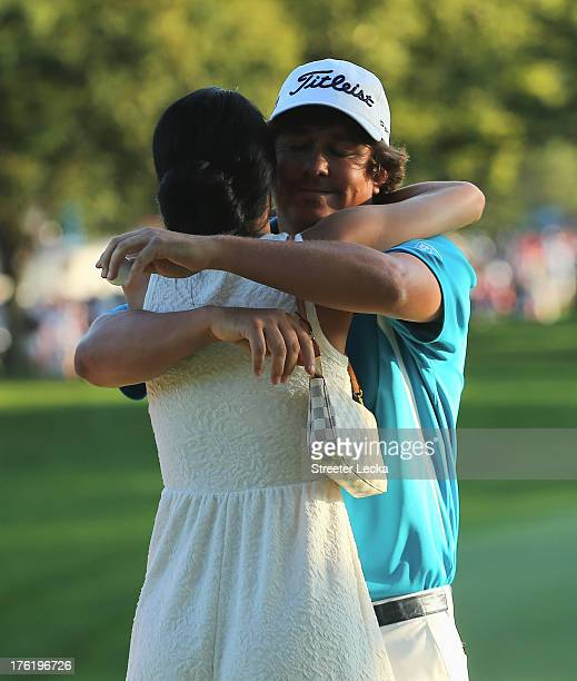 Jason Dufner of the United States hugs his wife Amanda after his twostroke victory at the 95th PGA Championship at Oak Hill Country Club on August 11...