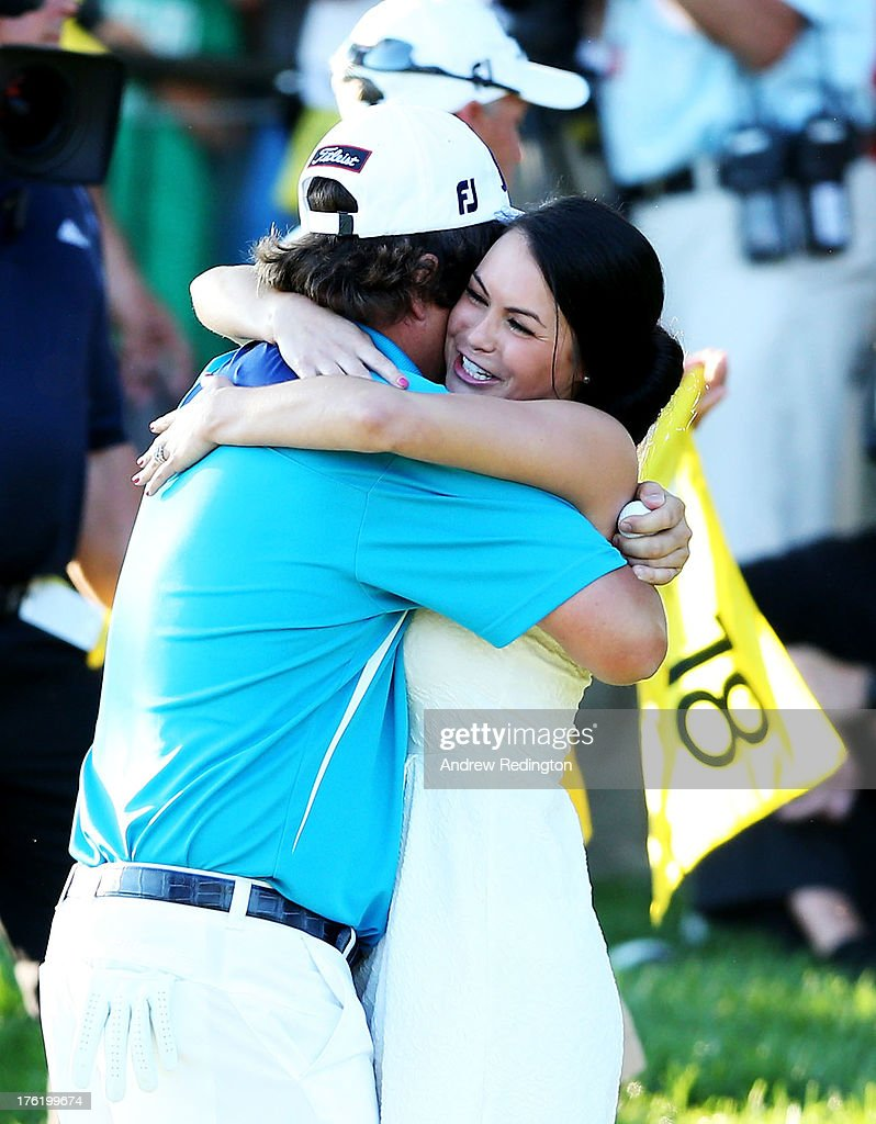 Amanda Redington jason dufner of the united states hugs his wife amanda on