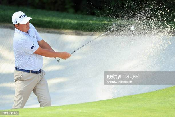 Jason Dufner of the United States plays a shot from a bunker on the 16th hole during round three of The Northern Trust at Glen Oaks Club on August 26...