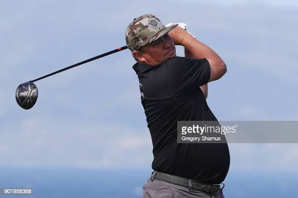 Jason Dufner of the United States plays his shot from the 13th tee during the third round of the Sentry Tournament of Champions at Plantation Course...