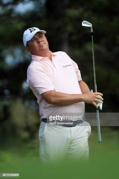 Jason Dufner of the United States plays his shot from the second tee during the final round of the Sentry Tournament of Champions at Plantation...