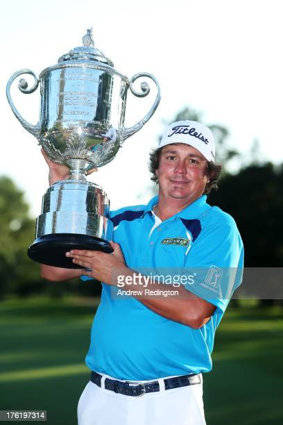 Jason Dufner of the United States poses with the Wanamaker Trophy after his two-stroke victory at the 95th PGA Championship at Oak Hill Country Club...