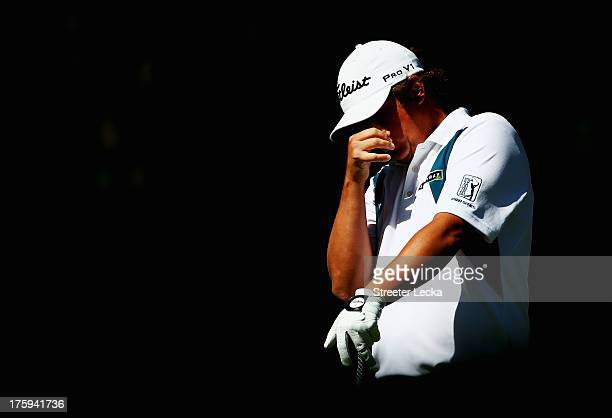Jason Dufner of the United States reacts to hitting a ball in the water on the fifth hole during the third round of the 95th PGA Championship at Oak...