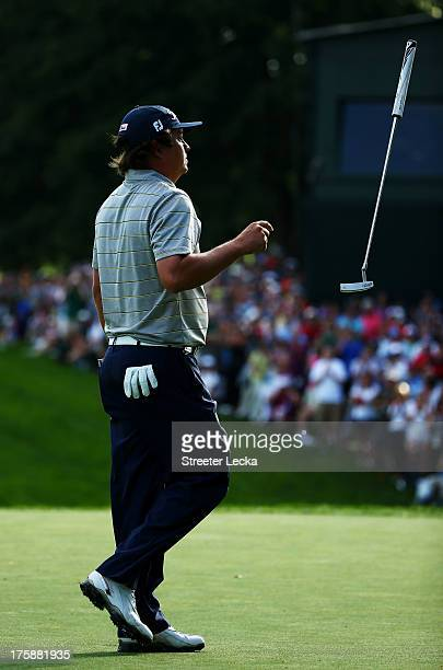 Jason Dufner of the United States tosses his putter on the 18th green after shooting a seven-under par 63 during the second round of the 95th PGA...